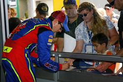 Kyle Bush signs autographs
