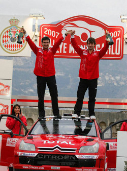 Podium: Winners Sébastien Loeb and Daniel Elena celebrate