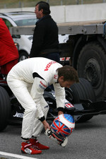 Jenson Button prepares to drive the Honda RA107