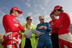 Kimi Raikkonen and Felipe Massa with Gary Hartstein, FIA doctor
