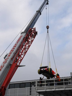 Spyker-Ferrari F8-VII is loaded to the truck via a crane