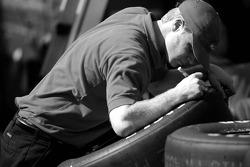 A crew member prepares the tires