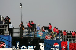 Crew members watch practice action from atop the haulers