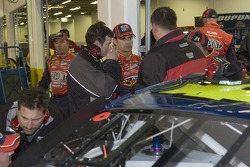 Jeff Gordon talks with crew after he exits the shootout