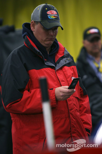 A Dupont Chevy crew member makes phone calls