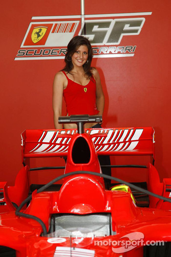 A girl with a Ferrari F1 car