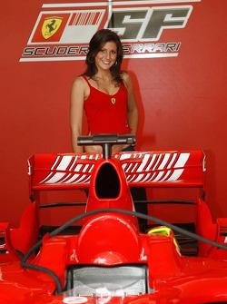 A girl with a Ferrari F1 car