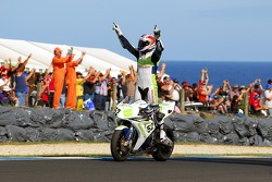James Toseland celebrates with the crowd during his victory lap after winning race two