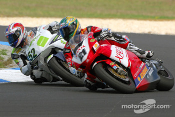Troy Bayliss rounds James Toseland on turn 4 then goes on to win by nearly 2 seconds after Toseland had led for 18 laps