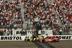 Kyle Busch takes the checkered flag ahead of Jeff Burton