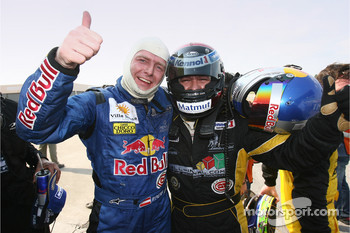 Race winner Christophe Bouchut celebrates with Philipp Peter