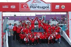 Podium: winners Sébastien Loeb and Daniel Elena celebrate with  Citroen Total WRT team members