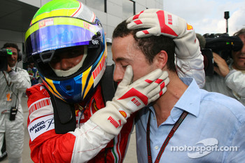 Pole winner Felipe Massa celebrates with his manager Nicolas Todt