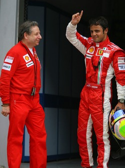 Pole winner Felipe Massa celebrates with Jean Todt