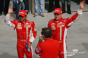 Pole winner Felipe Massa celebrates with Kimi Raikkonen and Jean Todt