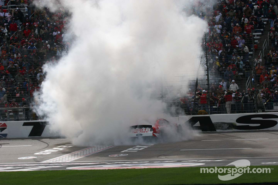Matt Kenseth's car is enveloped in smoke during his burn out