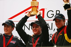 L-R 2nd place Robbie Kerr, Driver of A1Team Great Britain with 1st place Jonny Reid, Driver of A1Team New Zealand and 3rd place Nico Hulkenberg, Driver of A1Team Germany