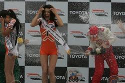 Podium: race winner Sébastien Bourdais sprays champagne
