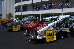 The cars of Ashley Force (foreground) and John Force
