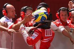 Pole winner Felipe Massa, Scuderia Ferrari celebrates pole position with his team