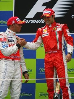 Podium: race winner Felipe Massa celebrates with Lewis Hamilton