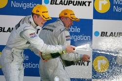 Podium: Paul di Resta, Persson Motorsport AMG Mercedes and Mika Hakkinen, Team HWA AMG Mercedes, spraying champagne