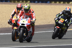 Andrea Iannone, Ducati Team and Marc Marquez, Repsol Honda team and Bradley Smith, Tech 3 Yamaha