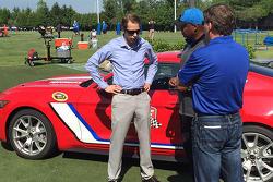 Brad Keselowski with Detroit Lions Head Coach Jim Caldwell and Michigan International Speedway President Roger Curtis