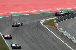 Nico Rosberg, Mercedes AMG F1 W06 leads team mate Lewis Hamilton, Mercedes AMG F1 W06, Sebastian Vettel, Ferrari SF15-T, and Valtteri Bottas, Williams FW37