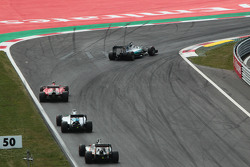Lewis Hamilton, Mercedes AMG F1 W06 leads Sebastian Vettel, Ferrari SF15-T, Valtteri Bottas, Williams FW37 and Nico Hulkenberg, Sahara Force India F1 VJM08