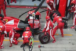 Sebastian Vettel, Ferrari SF15-T has a long pit stop with a stuck rear right wheel