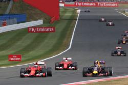 Kimi Raikkonen, Ferrari SF15-T and Daniil Kvyat, Red Bull Racing RB11 battle for position