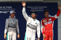 Second place Nico Rosberg and polesitter Lewis Hamilton, Mercedes AMG F1 and third place Sebastian Vettel, Ferrari SF15-T