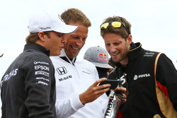 (L to R): Nico Rosberg, Mercedes AMG F1 with Jenson Button, McLaren and Romain Grosjean, Lotus F1 Team on the drivers parade