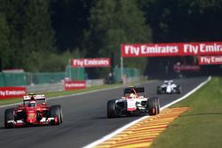 (L to R): Kimi Raikkonen, Ferrari SF15-T and Roberto Merhi, Manor F1 Team
