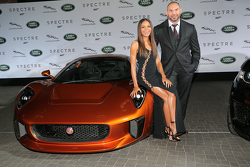Naomi Harris ( James Bond Spectre, Miss Moneypenny ) and Dave Bautista ( James Bond Spectre, Mr. Hinx ) next to a Jaguar C-X75 during the presentation of the Jaguar Land Rover vehicles starring in the new Bond film Spectre