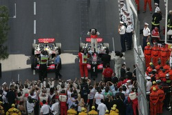 Race winner Fernando Alonso celebrates with Lewis Hamilton