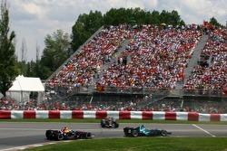 Rubens Barrichello, Honda Racing F1 Team, RA107 and David Coulthard, Red Bull Racing, RB3, pass Mark Webber, Red Bull Racing, RB3