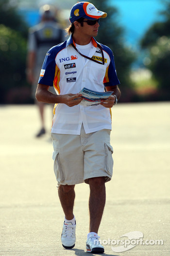 Nelson A. Piquet, Test Driver, Renault F1 Team arrives at the track and reads THE RED BULLETIN