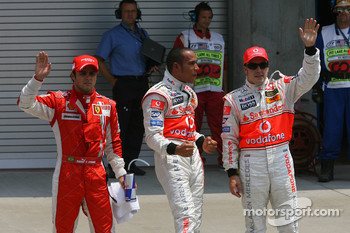 Felipe Massa, Scuderia Ferrari with Lewis Hamilton, McLaren Mercedes who gets pole position and Fernando Alonso, McLaren Mercedes