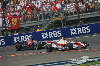 Jarno Trulli, Toyota Racing, TF107 leads Scott Speed, Scuderia Toro Rosso, STR02