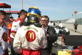 Carl Haas congratulates Sébastien Bourdais on winning the provisional pole