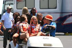 A golf cart full of Champ Car girls