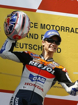 Podium: race winner Dani Pedrosa celebrates