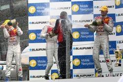Podium: the Audi men on the podium spraying the champagne
