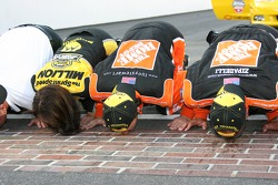 Tony Stewart is joined by Home Depot Chevrolet team members as they kiss the bricks