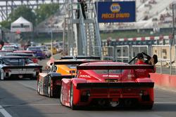 DP cars line up on pitlane
