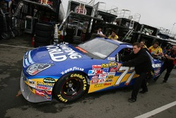 Camping World Ford crew members push the car