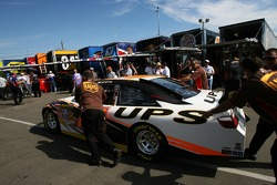 UPS Toyota crew members push the car to tech inspection