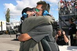 Hyper Sport team members celebrate the pole position of Joe Foster